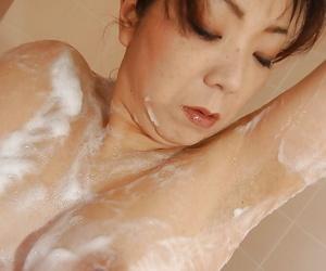 Mature asian sprog Yoriko Akiyoshi taking shower increased by caressing herself