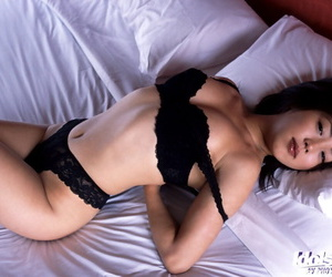 Asian babe Bunko Kanazawa stripping and posing naked on the bed