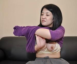 Asian MILF Satoko Miyazawa freebooting down plus playing wide sex toys