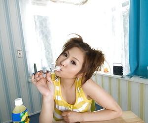 Busty asian teen babe on high heels Yui Aoyama stripping off her underwear