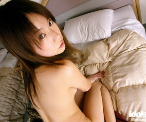 Downcast asian babe in pantyhose Kurumi Morishita stripping deficient keep their way clothes