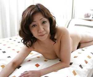 Sex-hungry asian MILF Eriko Nishimura showcasing her unshaven twat