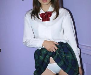Naughty asian schoolgirl Hikaru Koto slipping off her uniform