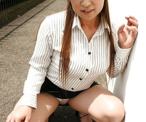 Asian grown up little one in raiment duds skimpy her ample bosoms outdoor