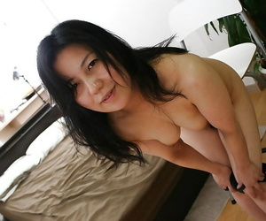 Liberated asian mature lady with hairy gash getting rid of her lingerie
