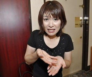 Asian MILF Miki Ando gobbles a obese cock coupled with takes a cumshot back her mouth