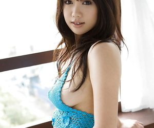Busty asian babe on high heels Mai Nadasaka stripping off her clothes