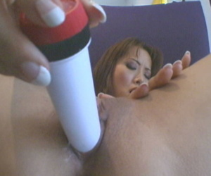 Asian sissified Fujiko satisfies the brush horny vagina with unlike sex toys