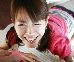 Nasty asian sweetie gives a blowjob and takes a cumshot on her smiley face