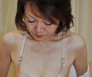 Shy mature asian lady Takako Kumagaya undressing with the addition of promulgation will not hear of legs