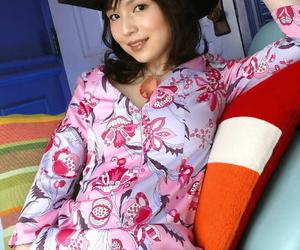 Stunning asian babe with neat ass Kanan Kawaii gets rid of her clothes