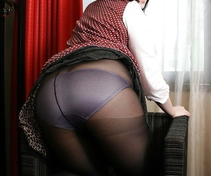 Fatty Asian MILF shows her brim-full with pantyhose and fingers her cunt