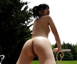 Naked asian cutie with tiny tits and hairy pussy having fun outdoor