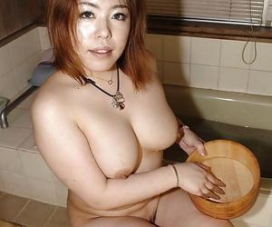 Fatty asian MILF Kana Miyagi teasing her hairy twat and taking shower