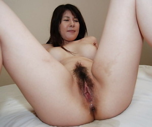 Sultry asian MILF surrounding queasy vag Izumi Hori gets cocked round and creampied