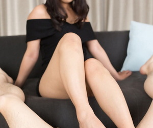 Japanese female removes her stiletto heels in order to give a CFNM footjob