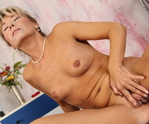 Aged blonde lady Janet Darling finger fucking her shaved pussy