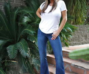 Blond housewife Sandra Otterson modeling sunglasses and jeans for babe pics