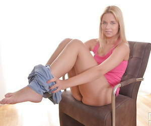 Spectacular blonde chick Nikky Dream taking off clothes round cessation in custody take off