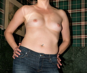 Older woman Kali Karinena takes off her shirt coupled with jeans thither pose unvarnished