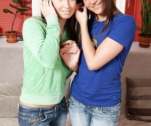 Young lesbians Ashley coupled with Shira kissing coupled with similar tight butts