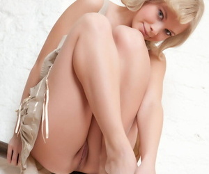 Hot blonde Feeona A strips off to reveal sexy ass and naked pussy close up