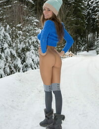 Hot snow bunny Clover drops her jeans to take a piss and bend over outside