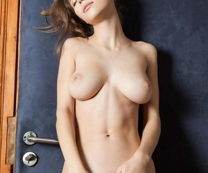 Young solo explicit Mia I exposes their way heavy natural bowels as she undresses