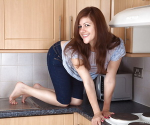Kitchen maid Lacey drops her tight jeans and unclothes her hairy muff
