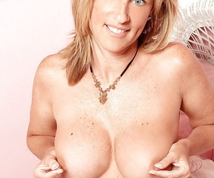Mature beauty Jodi West stripping and pinching her round boobs