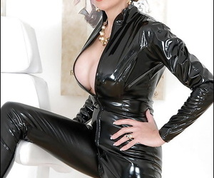 Cyrvy full-grown little one in glasses exposing her fuckable body unseeable with latex