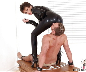 Irregular mature lady in latex outfit playing with their way human pet