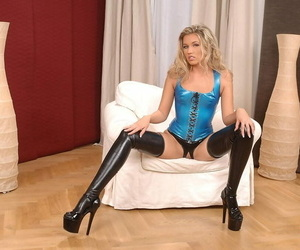 X MILF Cherry Jul shows off her pussy to latex stockings and lingerie