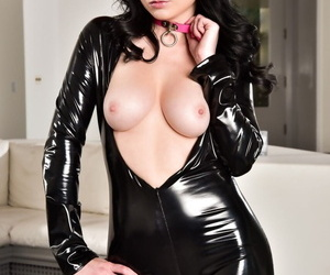 Gothic babe Veruca James strips her tight latex outfit off and poses