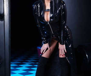 Brunette babe Aletta Ocean posing for fetish shoot in latex and long boots