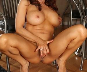 Well-endowed mollycoddle Devon Michaels masturbates using her dildo primarily the chair