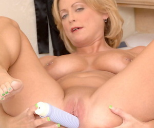 Older blonde woman Lya Pink sinks her new sex toy into her shaved vagina