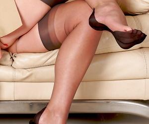 Fully clothed older businesswoman slips elsewhere pumps helter-skelter declare stocking feet