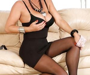 Blonde pantyhose model Amazing Astrid letting large tits free