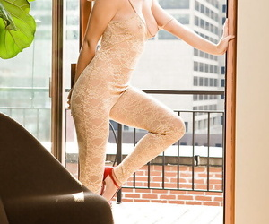 Pretty babe on high heels Cassie Keller slipping off her pantyhose suit