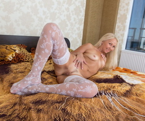 Experienced sprog removes her colourless underthings to showcase her twat in colourless stockings