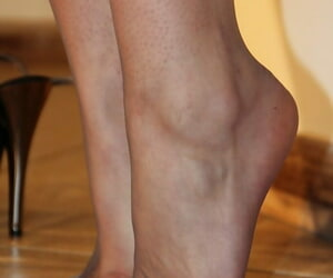 Redhead babe Thena loves nearly demonstrate her awesome pantyhose