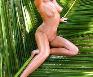 Cute european brunette Angelica showing oiled up body coupled with bosom