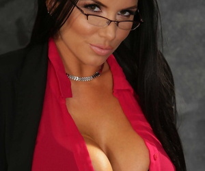 Dark haired schoolteacher Romi Rain strips to black stockings at her desk