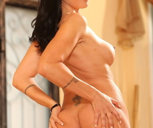Middle-aged ill-lit Zoey Holloway strips to say no to black stockings