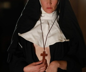 American nun Mona Wales prays be useful to forgiveness before posing in the naked