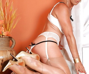 Shove around of age wench in stockings luring off say no to clothes plus lingerie
