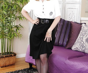 Matured lady Nina Hartley undressing and spreading her nylon clad fingertips
