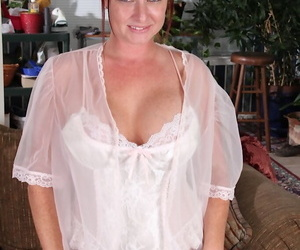 Redhead mature vixen in white nylons slowly uncovering her goods