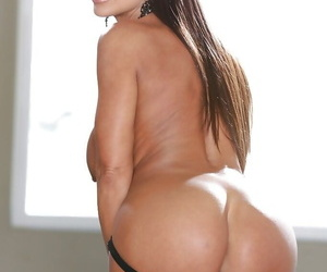 Mature brunette Lisa Ann shows her great big boobies and pussy